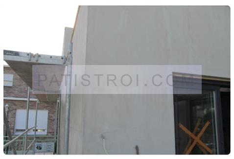 Стената на 2-ри етап - измазани топлоизолационни плочи